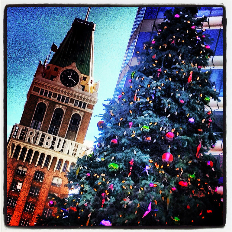 . A Chirstmas tree in City Center is photographed with the Tribune Tower in the background at 12:12pm on Dec. 12, 2012 in Oakland, Calif. This photograph was taken with a phone using Dynamic Light and Instagram applications to create the image. (Aric Crabb/Staff)