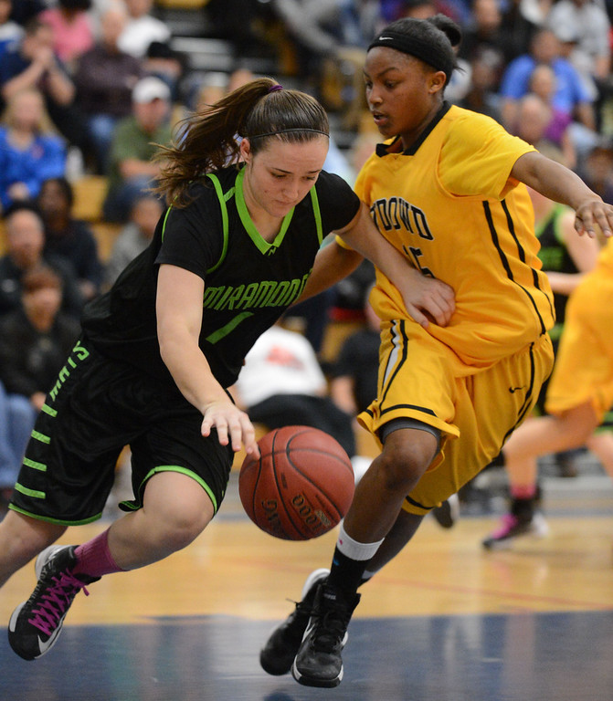 . Miramonte High\'s Megan Reid (1) left, gets past Bishop O\'Dowd High\'s Aisia Robertson (15) in the second period of their Division III North Coast Section basketball game in Dublin, Calif., on Saturday, March 2, 2013. Bishop O\'Dowd High went on to win the game 77-48. (Doug Duran/Staff)