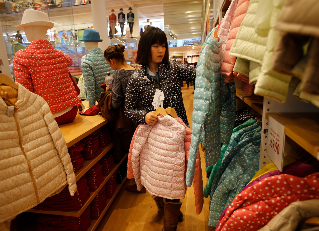 . Nicole Liu, from Zheng Zhou, China, who is attends the Academy of Art, shops for a down jacket at Uniqlo clothing store on Powell St. in downtown San Francisco, Calif. on Thursday, Jan. 17, 2013.  Liu has shopped at the stores in China.  They opened their store in San Francisco in October 2012.  (Nhat V. Meyer/Staff)