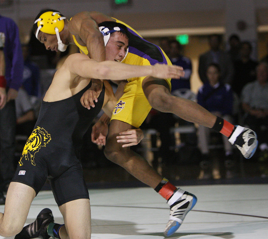 . Gilroy\'s Nikko Villareal grabs the legs of Riordan\'s Elijah Davis on his way to victory in the 138 pound class during the CCS wrestling championships at Independence High School in San Jose, Calif. on Saturday, Feb. 23, 2013. (Jim Gensheimer/Staff)