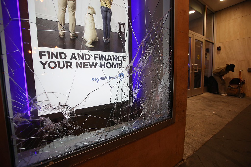 . Smashed windows are seen at the Chase Bank on Broadway and 14th Street in downtown Oakland, Calif., early Sunday, July 14, 2013. Protesters also lit several small fires on Telegraph Avenue and sprayed graffiti after learning that George Zimmerman had been found not guilty in the shooting death of Trayvon Martin in Sanford, Fla. (Jane Tyska/Bay Area News Group)