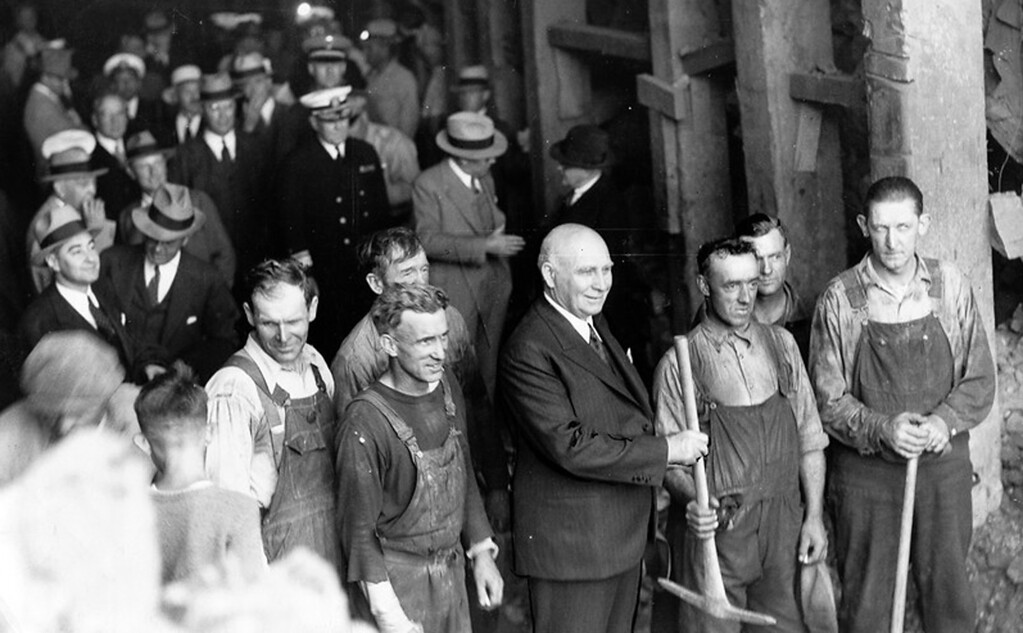 . July 1934 - Governor Frank F. Merriam is shown standing with a group of workmen on the east side of the Yerba Buena island tunnel. (Oakland Tribune Photo)