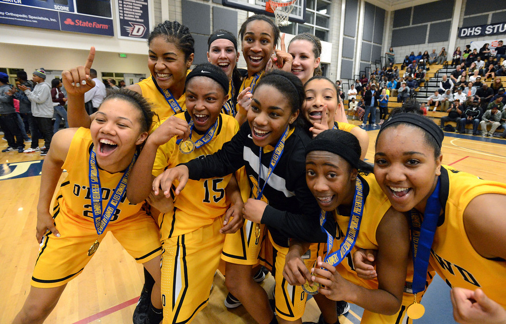 . Members of the Bishop O\'Dowd High girls basketball team celebrate after winning their Division III North Coast Section basketball game 77-48 against Miramonte High in Dublin, Calif., on Saturday, March 2, 2013. (Doug Duran/Staff)