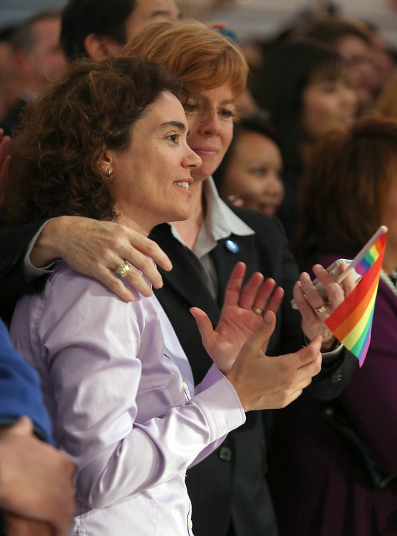 ". Zoe Dunning, left, and her partner Pam Grey, of San Francisco, celebrate as they watch a screening of the Supreme Court\'s decision on Proposition 8 and the Defense of Marriage Act. at City Hall in San Francisco, Calif., on Wednesday, June 26, 2013. Dunning is vice-chair of the San Francisco Democratic party and a former military officer who crusaded against the ""Don\'t Ask, Don\'t Tell\"" policy. The U.S. Supreme Court dismissed California\'s Proposition 8 and declared the 1996 Defense of Marriage Act unconstitutional. (Jane Tyska/Bay Area News Group)"