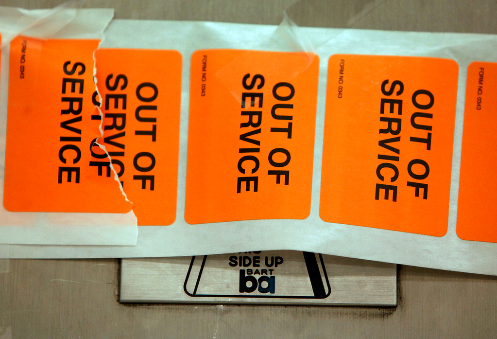 . Out of Service stickers cover the gates at the closed Montgomery Street BART station in San Francisco, Calif., Monday morning, July 1, 2013, the first day of the BART strike. (Karl Mondon/Bay Area News Group)