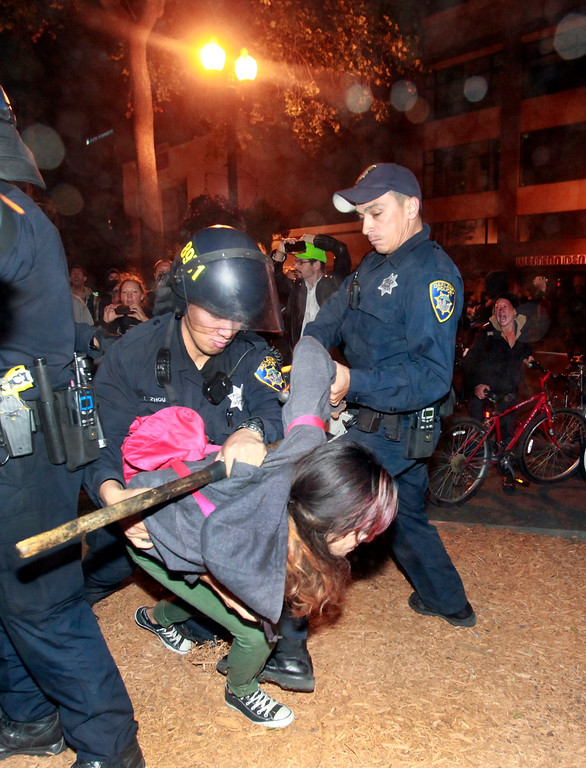 . Oakland police began making arrests at 10:45 PM after protesters broke windows at the Men\'s Wearhouse on Broadway at 15th St., on the third day of unrest over the acquittal of George Zimmerman on Monday, July 15, 2013 in Oakland, Calif. (Karl Mondon/Bay Area News Group)