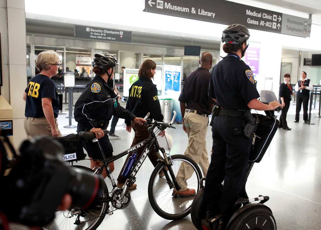 . Deborah Hersman, chair of the National Transportation Safety Board, is escorted through San Francisco International Airport Sunday afternoon, July 7, 2013, after briefing reporters on the investigation into yesterday\'s crash of an Asiana Airlines that killed two people. (Karl Mondon/Bay Area News Group)