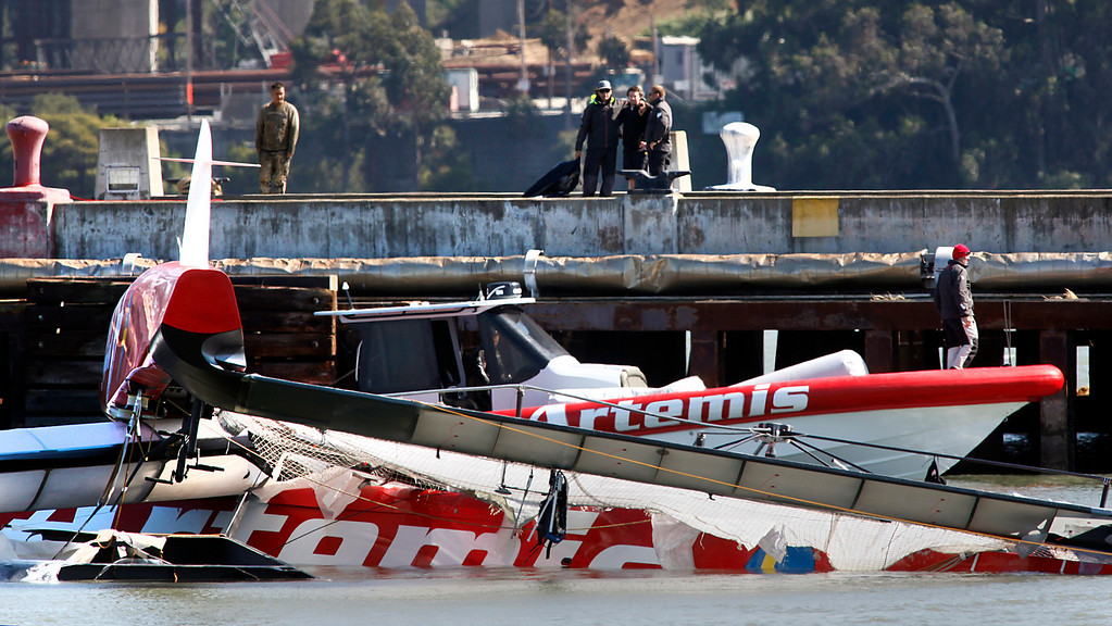 . Artemis support team members hug on a Treasure Island pier after Sweden\'s capsized AC72 catamaran was towed in following a fatal accident on San Francisco Bay, Thursday, May 9, 2013. The Swedish team was practicing for this summer\'s America\'s Cup races. (Karl Mondon/Bay Area News Group)