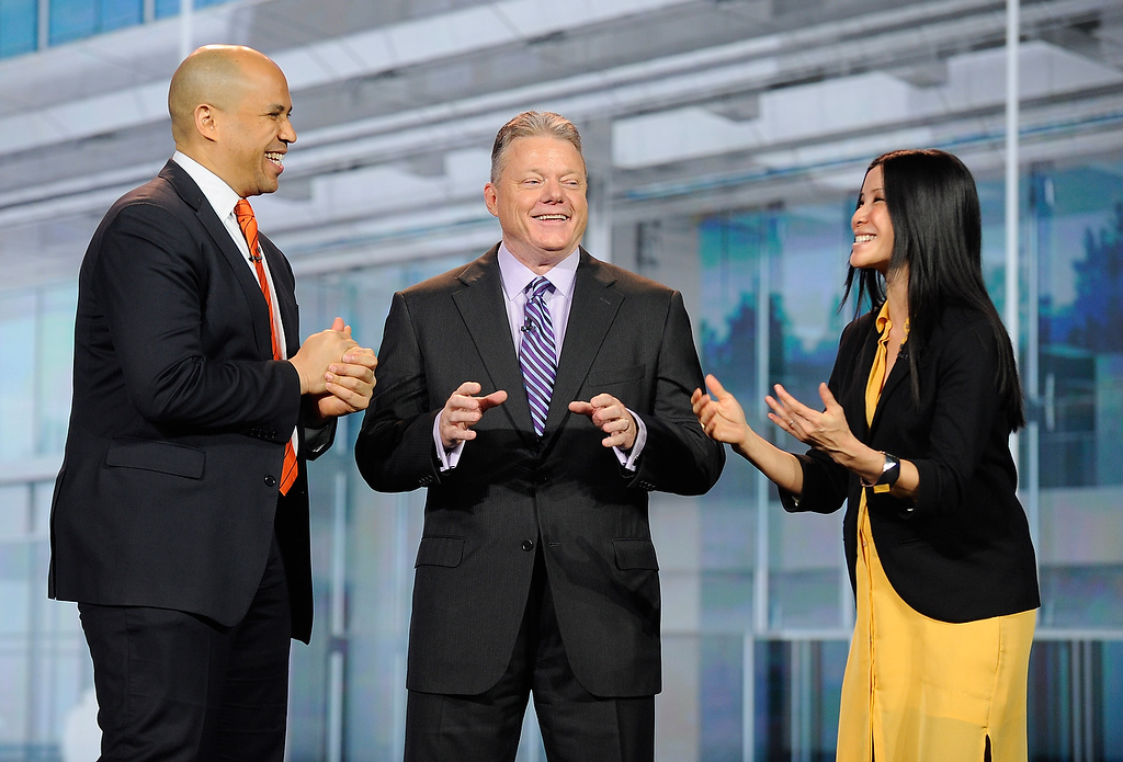 . (L-R) Mayor of Newark, New Jersey Cory Booker, Panasonic North America CEO Joe Taylor and host Lisa Ling appear on stage during a keynote address at the 2013 International CES at The Venetian on January 8, 2013 in Las Vegas, Nevada. (Photo by David Becker/Getty Images)