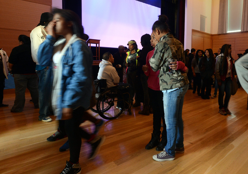 . Students slowly exit the auditorium following a memorial for slain teenager Lee Weathersby III at Alliance Academy in Oakland, Calif. on Wednesday, Jan. 8, 2014. (Kristopher Skinner/Bay Area News Group)
