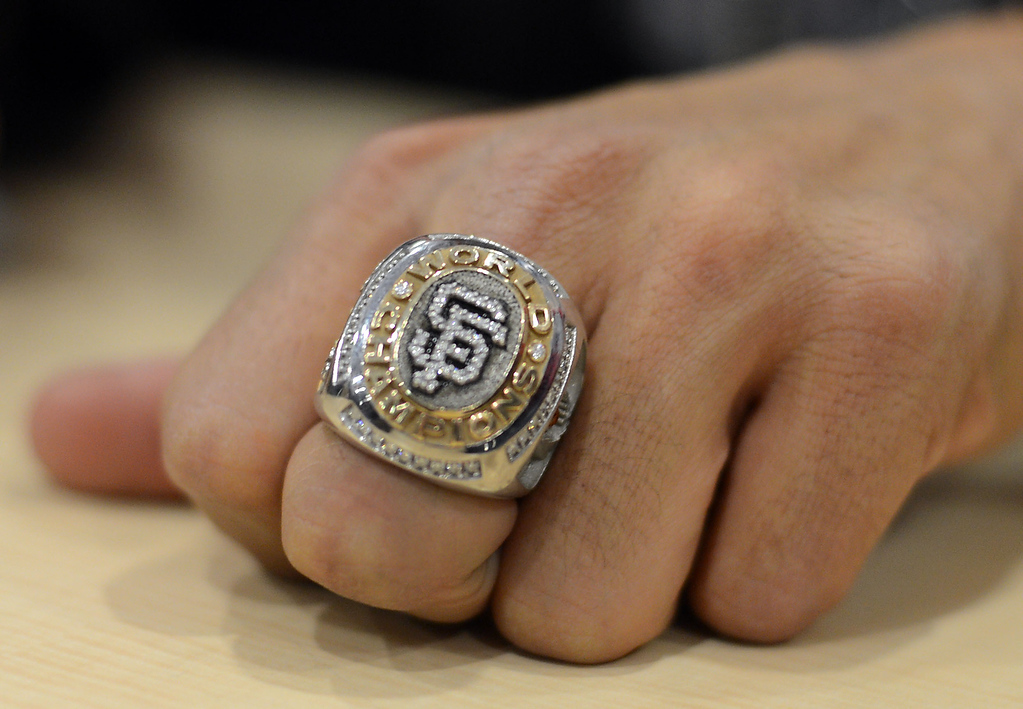 . Giants reliever Sergio Romo wears his San Francisco Giants 2012 World Series championship ring while signing autographs on Wednesday, Dec. 12,  2012, at Kinder\'s Meats and Deli in Pleasant Hill, Calif.  (Susan Tripp Pollard/Staff)