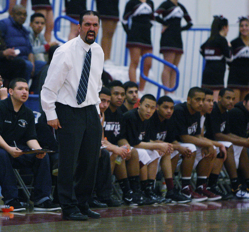 . Piedmont Hills coach Pete Simos gets after his team in the second quarter during the Blossom Valley Athletic League boys basketball championship game at Independence High School in San Jose, Calif. on Friday, Feb. 15, 2013. (Jim Gensheimer/Staff)