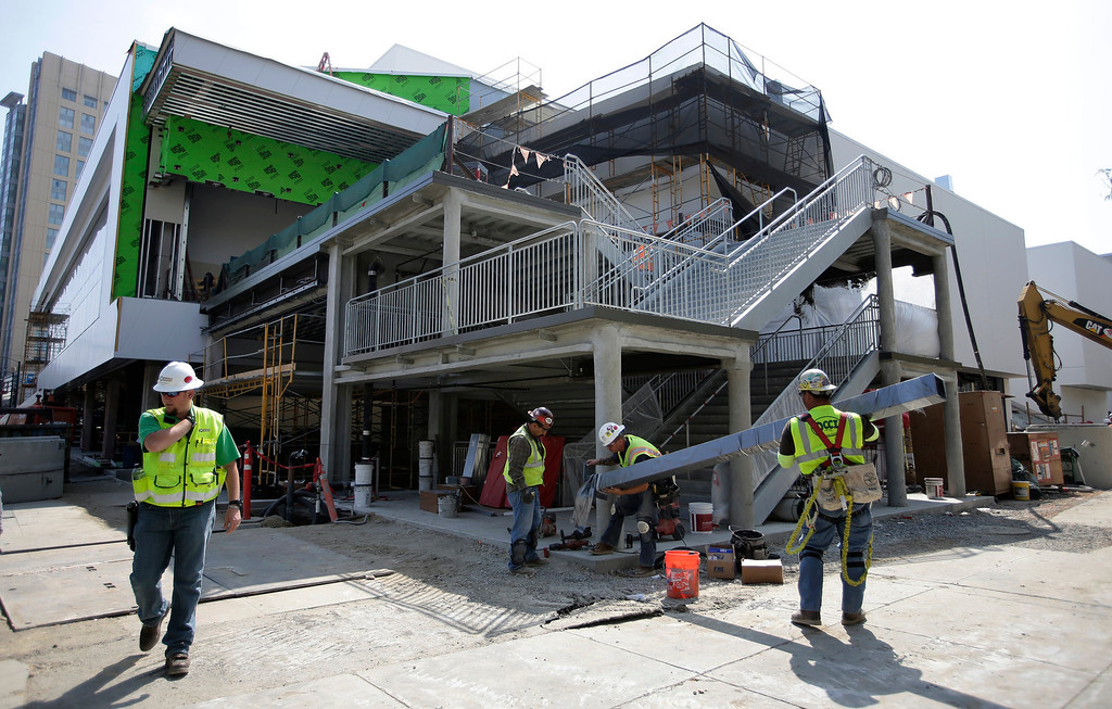 . Work on the 125,000-square-foot  expansion and renovation of the San Jose McEnery Convention Center is seen from San Carlos St. in San Jose, Calif. on Tuesday, Aug. 6, 2013.  (Gary Reyes/Bay Area News Group)