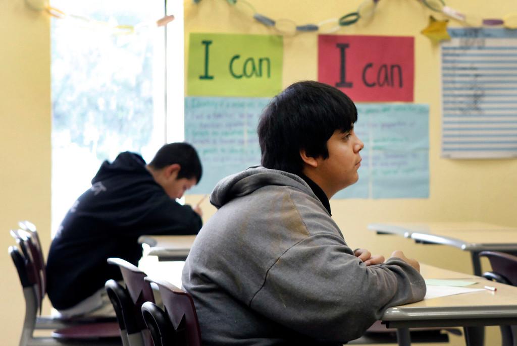 . Angel Lopez-Camacho listens to his algebra instructor Audrey Gross at ACE Charter High School in San Jose, Calif. on Wednesday, Dec. 05, 2012.  (Karl Mondon/Staff)