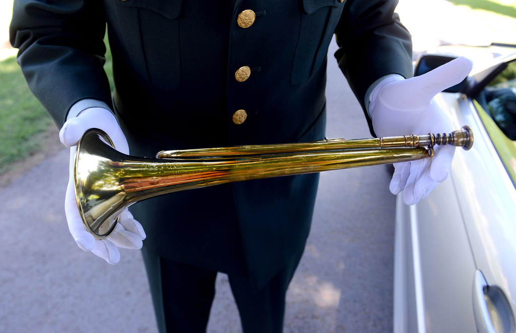 . Frank Dorritie holds a circa 1916 bugle before he plays taps at the Union Cemetery on Thursday, May 23, 2013, in Brentwood, Calif. (Susan Tripp Pollard/Bay Area News Group)
