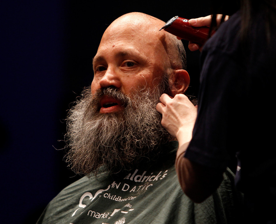 . Rick Ehrhart has his head shaved for the St. Baldrick\'s Day head shaving event in support of research for pediatric cancer sponsored by the St. Baldrick\'s Foundation in the NetApp gymnasium at NetApp in Sunnyvale, Calif., on Thursday, March 14, 2013.  (Nhat V. Meyer/Staff)