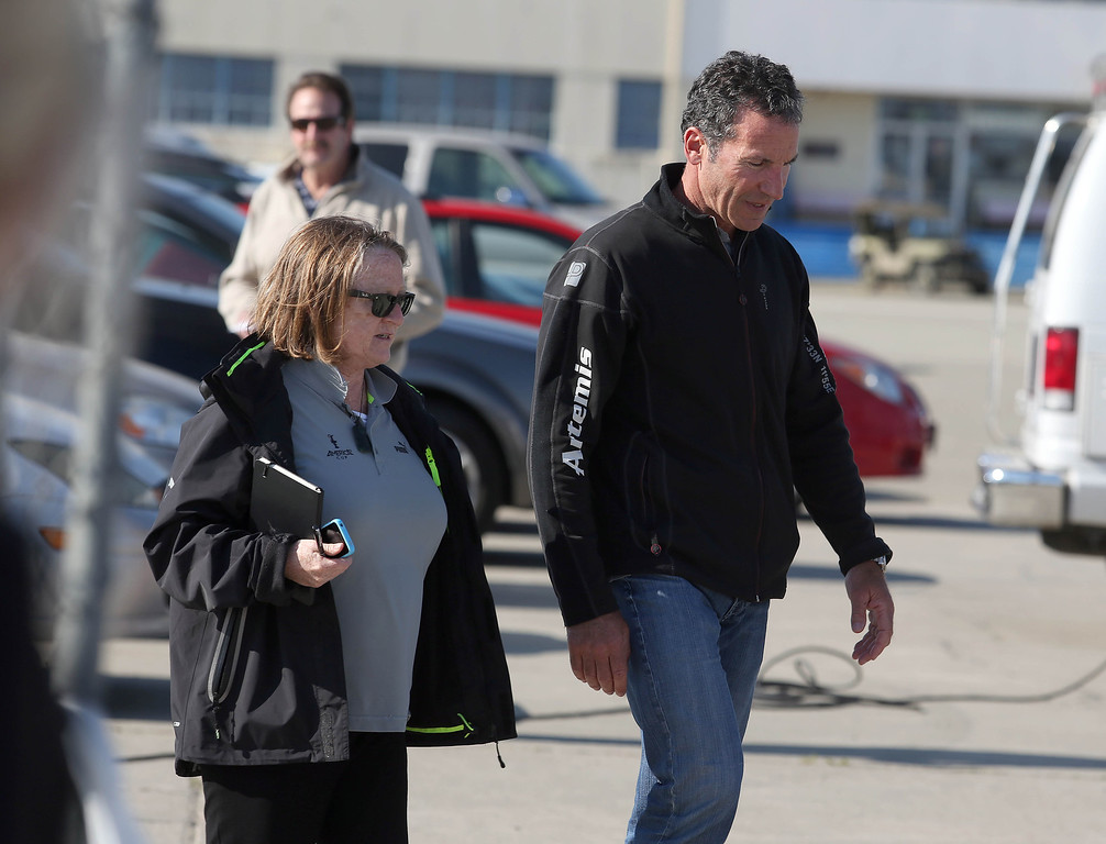 . Artemis Racing Chief Executive Officer Paul Cayard, right, and Amercia\'s Cup Director of Live Entertainment and Event Media Jane Eagleson, left, arrive to a short press conference at the Artemis Racing headquarters at the former Alameda Naval Air Station in Alameda, Calif., on Thursday, May 9, 2013. (Jane Tyska/Bay Area News Group)