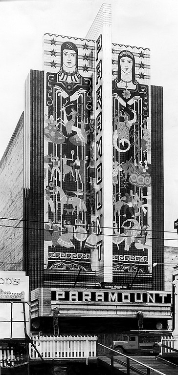 . Workers install the neon marquee of the Paramount Theatre in Oakland in 1931. The sign, which is 10 stories high, is emblazoned with lights and a mosaic that depicts a man and a woman holding four tiers of puppets. (Bay Area News Group Staff Archives)