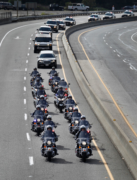 ". A procession of police officers from supporting agencies, coming from Santa Cruz, heads north on Highway 17 near Bear Creek Road on their way to HP Pavilion in San Jose Thursday, March 7, 2013. The procession was to the memorial service for Santa Cruz city police officers Loran ""Butch\"" Baker and Elizabeth Butler, shot to death on Feb. 26 when they followed up on a sexual assault investigation with an unstable man with a history of sexual assault. The gunman, Jeremy Goulet, was killed moments later by responding Santa Cruz County sheriff\'s deputies.  (Patrick Tehan/Bay Area News Group)"
