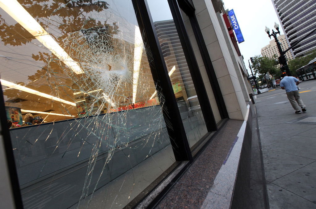 . Broken windows are yet to be replaced at Rite Aid on Broadway in Oakland, Calif., Monday, July 15, 2013, after a weekend of protest and late night violence. (Laura A. Oda/Bay Area News Group)