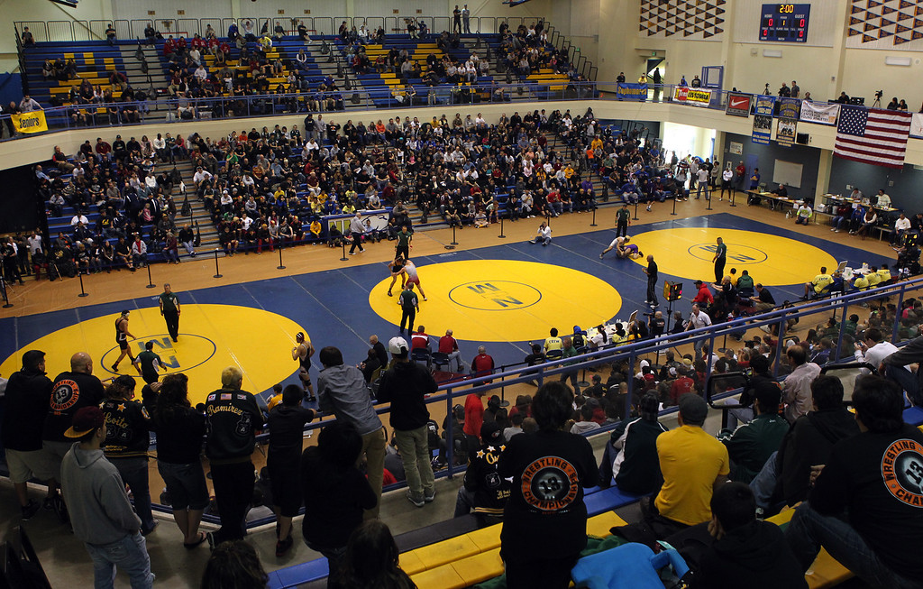 . Wrestlers face off in consolation matches at the North Coast Section wrestling championships held at Newark Memorial High School in Newark, Calif., on Saturday, Feb. 23, 2013. (Anda Chu/Staff)