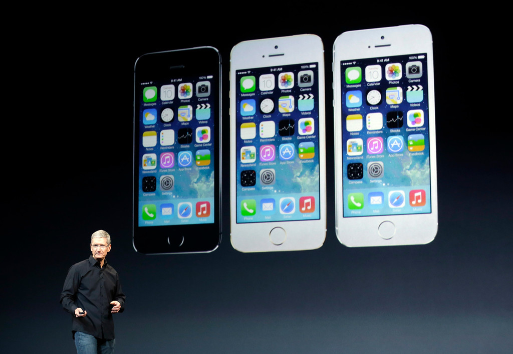 . Apple CEO Tim Cook speaks on stage before a new product introduction on Tuesday, Oct. 22, 2013, in San Francisco. (AP Photo/Marcio Jose Sanchez)