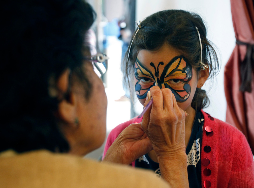 ". Seven-year-old Zoe Nguyen gets a butterfly face paint treatment from Rowena Chow at Hakone Estate and Gardens Lunar New Year of the Snake festival with a ""Chinese Village Fair\"" on Sunday afternoon, March 3, 2013 in Saratoga, Calif. (Karl Mondon/Staff)"