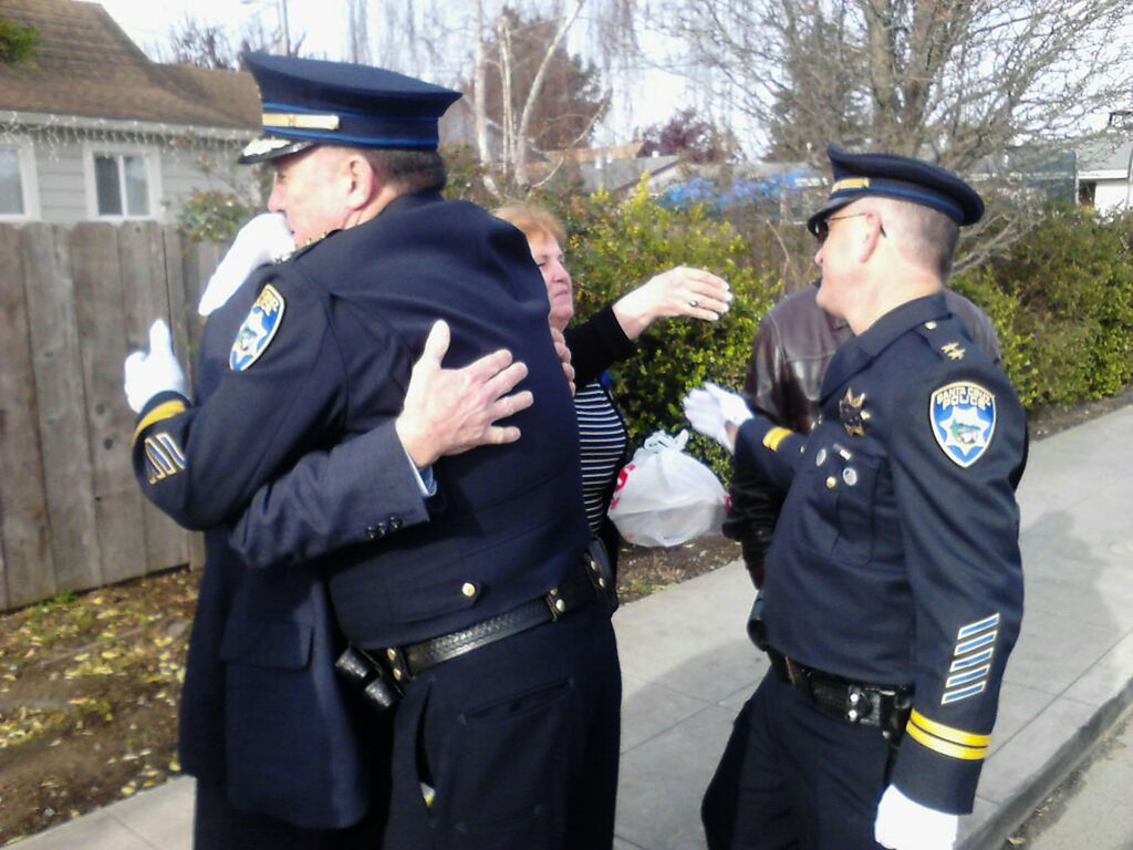 ". Santa Cruz Police Chief Kevin Vogel hugs Loran Baker, the father of slain Sgt. Loran ""Butch\'\"" Baker, while deputy chief Steve Clark greets Butch\'s mother Virginia Baker, who said, \""It\'s a sad day,\"" on Thursday, March 7, 2013, in Santa Cruz, Calif. The Bakers live in Fresno. (Cathy Kelly/Santa Cruz Sentinel)"