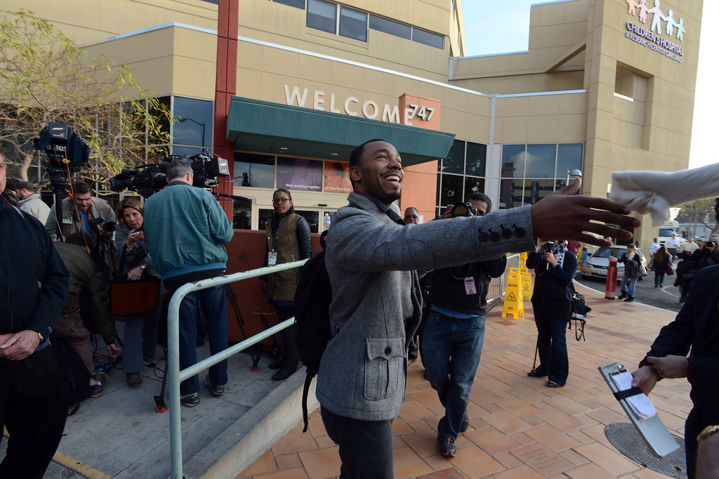 . Omari Sealey, uncle of Jahi McMath, greets a well-wisher after speaking to the media outside of Children\'s Hospital Oakland in Oakland, Calif., on Monday, Dec. 30, 2013. (Kristopher Skinner/Bay Area News Group)