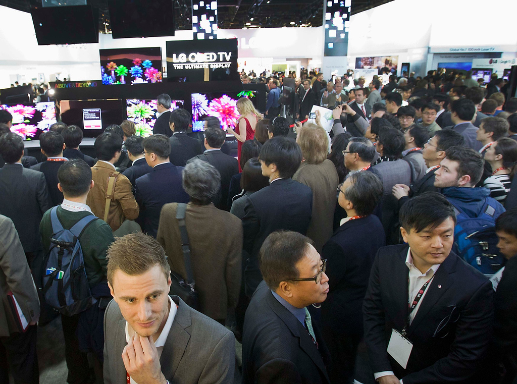 . Attendees crowd displays in the LG Electronics booth during the first day of the Consumer Electronics Show (CES) in Las Vegas January 8, 2013. (REUTERS/Steve Marcus)