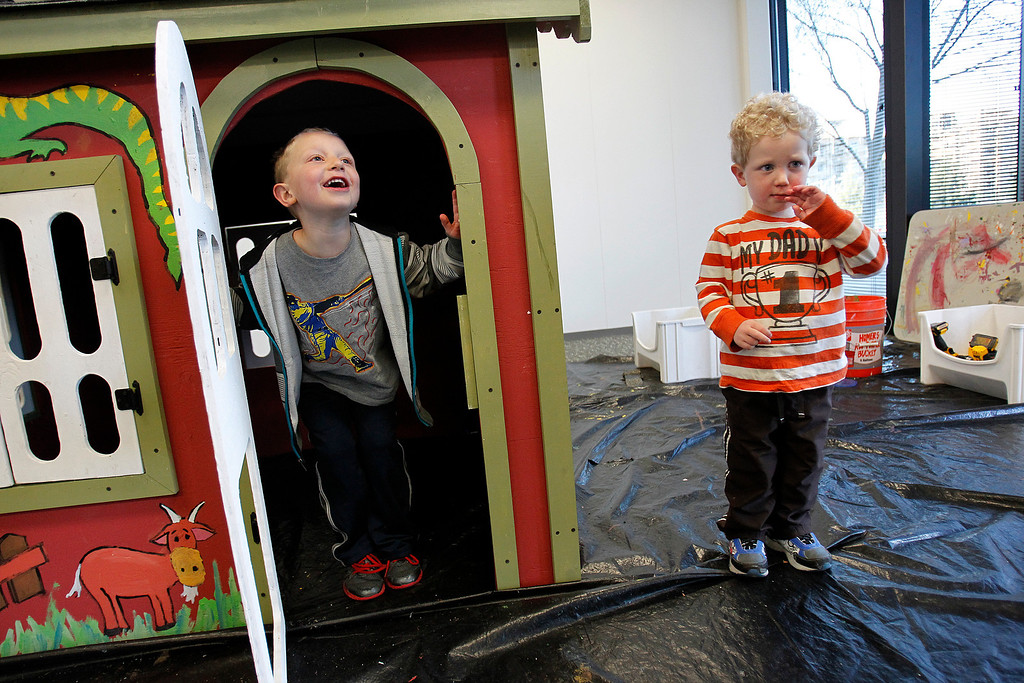 . From left, Jacob Shearer, 5, and Max Shearer, 2, check out their new playhouse  that was built by NetScout Systems employees and Habitat for Humanity volunteers at the NetScout offices in San Jose, Calif. on Thursday, Feb. 21, 2013.   (LiPo Ching/Staff)