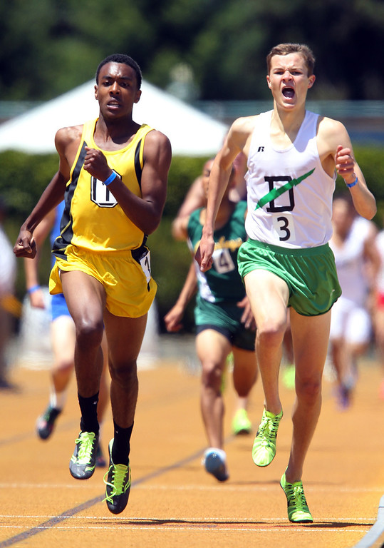 . Bishop O\'Dowd\'s Eugene Hamilton III, from left, and Sir Francis Drake\'s Clayton Hutchins compete in the boys 1600 meter final at the North Coast Section Meet of Champions at Cal\'s Edwards Stadium in Berkeley, Calif., on Saturday, May 25, 2013. (Anda Chu/Bay Area News Group)