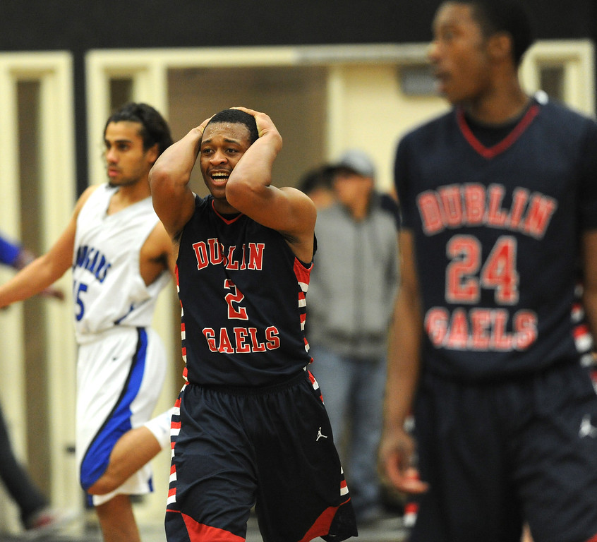. Dublin High\'s Cameron Moses (2) feels the pressure as time runs out against Newark Memorial High in their North Coast Section Division II high school boys championship game played at Washington High School in Fremont, Calif. on Friday, March 1, 2013. (Dan Honda/Staff)