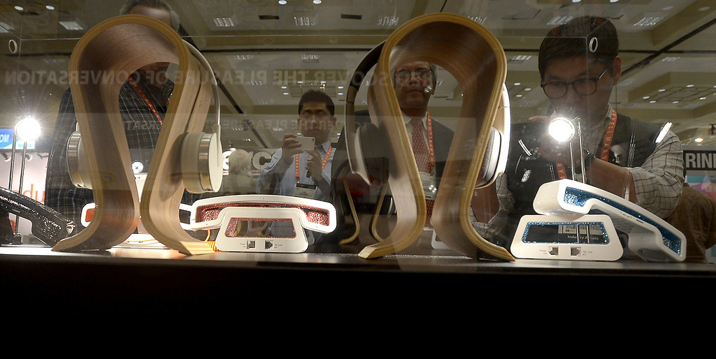 . Headphones and telephones are seen at the Swissvoice booth during the 2013 International CES at the Las Vegas Convention Center on January 8, 2013 in Las Vegas, Nevada. (JOE KLAMAR/AFP/Getty Images)