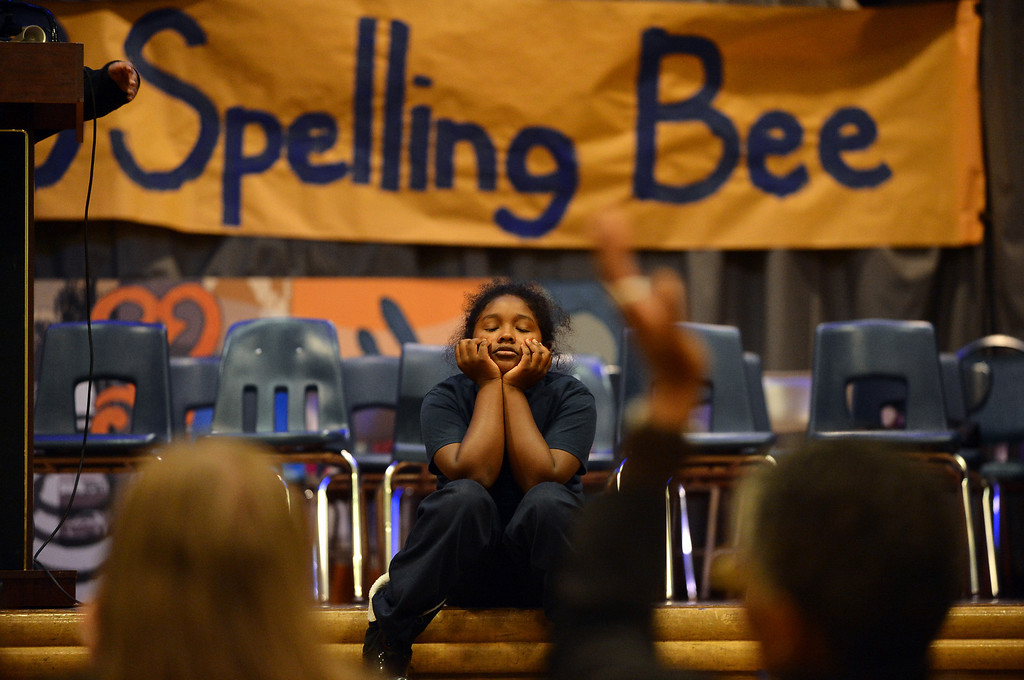 ". Sankofa Academy fifth-grader Aisha Ramsey can only listen as sixth-grader Adam Ansari correctly spells ""defunct\"" to win the school\'s second annual spelling bee in Oakland, Calif. on Wednesday, Jan. 23, 2013. Aisha finished second and will represent the elementary grades at the district level spelling bee in February. (Kristopher Skinner/Staff)"