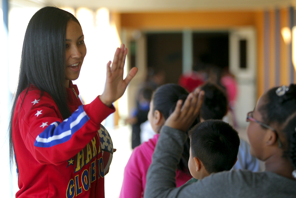 ". Harlem Globetrotters� rookie and Oakland native Tammy �T-Time� Brawner high fives students following a visit by her and teammate Slick Willie Shaw were the two presented the team\'s ""ABC\'s of Bullying Prevention\"" program at Laurel Elementary School in Oakland, Calif., on Wednesday, Jan. 16, 2013. (Anda Chu/Staff)"
