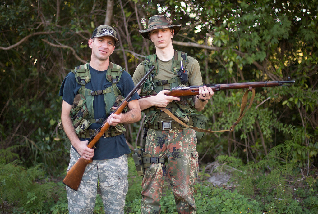 . Christopher Padgett, left, and Matthew Manus, from Sebring, Fla. leave their campsite in the Big Cypress National Preserve for their five-day python hunt. The recommended method for killing pythons is a gunshot to the brain, or decapitation. (AP Photo/J. Pat Carter)