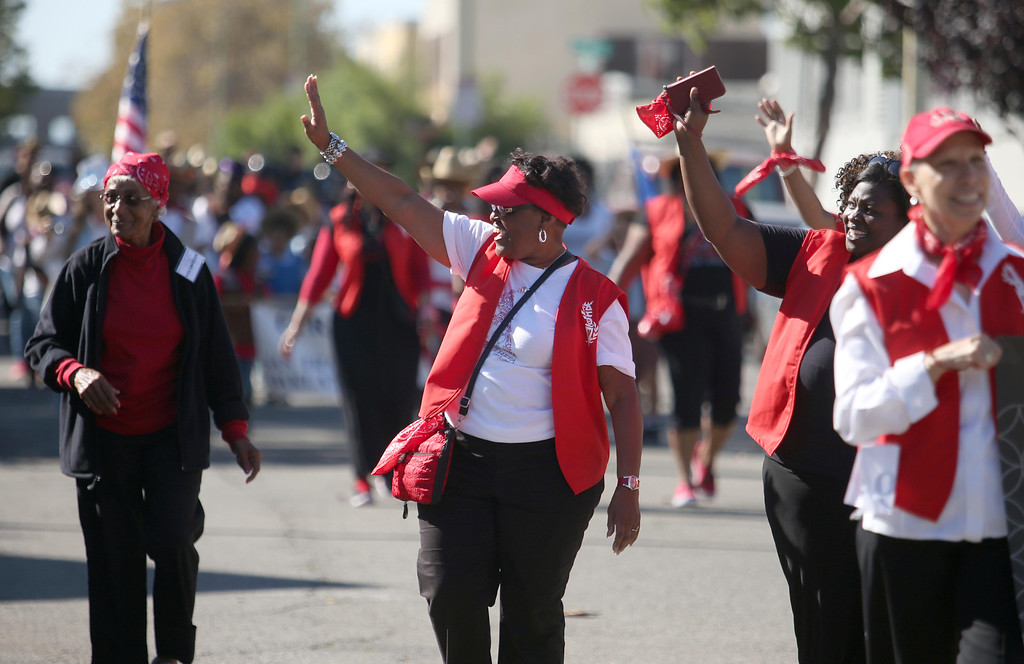 . Betsy Rogers and members of the Delta Sigma Theta Sorority Inc., march during the 39th annual Oakland Black Cowboy Parade and Heritage Festival in Oakland, Calif., on Saturday, Oct. 5, 2013. The event also featured food, entertainment and pony rides for kids. The Oakland Black Cowboy Association began in 1975 and educates the public about the role that black cowboys played in history and building of the west. (Jane Tyska//Bay Area News Group)