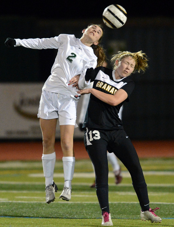 . San Ramon Valley\'s Melissa Lewis (2) left, heads the ball away from Granada High\'s Kaitlyn Lipman (13) in the first half of their soccer game in Danville, Calif., on Thursday, Jan. 17, 2013. (Doug Duran/Staff)