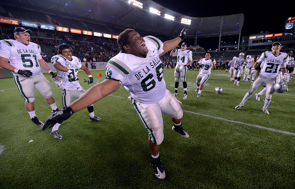 . De La Salle Spartans\' Xavier Banks (68) does cart wheels as he celebrates their win over Centennial Huskies in the Open Division during the 2012 CIF State Football Championship at Home Depot Center in Carson , Calif. on Saturday, Dec. 15, 2012. De La Salle defeated Centennial 48-28. (Jose Carlos Fajardo/Staff)