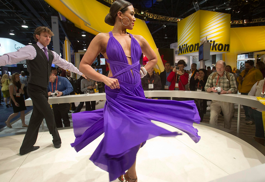 . Dancers Andrew Winnet and Anya Fuchs perform in a booth featuring Nikon 1 cameras during the first day of the Consumer Electronics Show (CES) in Las Vegas January 8, 2013. (REUTERS/Steve Marcus)