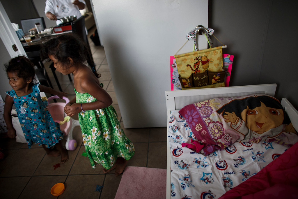 . Since the family moved to their mobile home from a motel recently, Clarissa Taitano\'s two daughters, A\'Riyah Jackson, 5, right, and I\'Yannah Jackson, 3, sleep in the same bed in their mobile home on May 24, 2013, in San Jose. The family recently moved to their mobile home after living in a Santa Clara motel for 64 days. (Dai Sugano/Bay Area News Group)