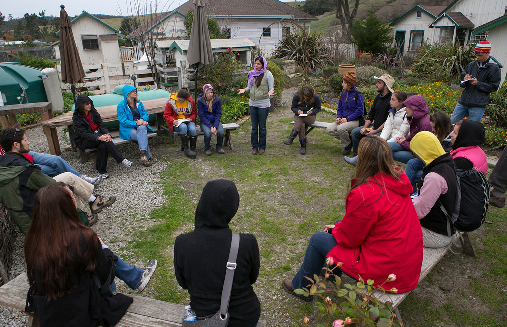 . Adriana Serrano, middle, talks with participants in the annual EcoFarm Conference who visited Harley Farms.