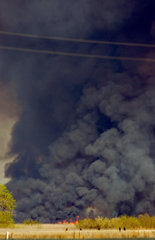 . Flames are visible in what was described as a vegetation fire visible from Pittsburg, Calif., as well as other parts of the Bay Area on Sunday, March 17, 2013. The fire reportedly was burning near Sherman Island in the Delta according to Cal Fire. (Cindi Christie/Staff)
