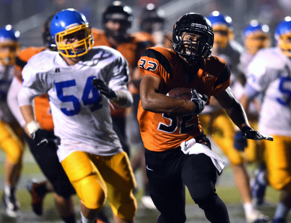 . <p>19. KARRIS JOHNSON � RUNNING BACK � CALIFORNIA</p> Johnson (32) runs past Foothill High\'s Will Theofanopoulas (54) to score a touchdown in their North Coast Section Division 1 quarterfinal high school football playoff game played at California High School in San Ramon, Calif. on Friday, November 16, 2012. (Dan Honda/Staff)