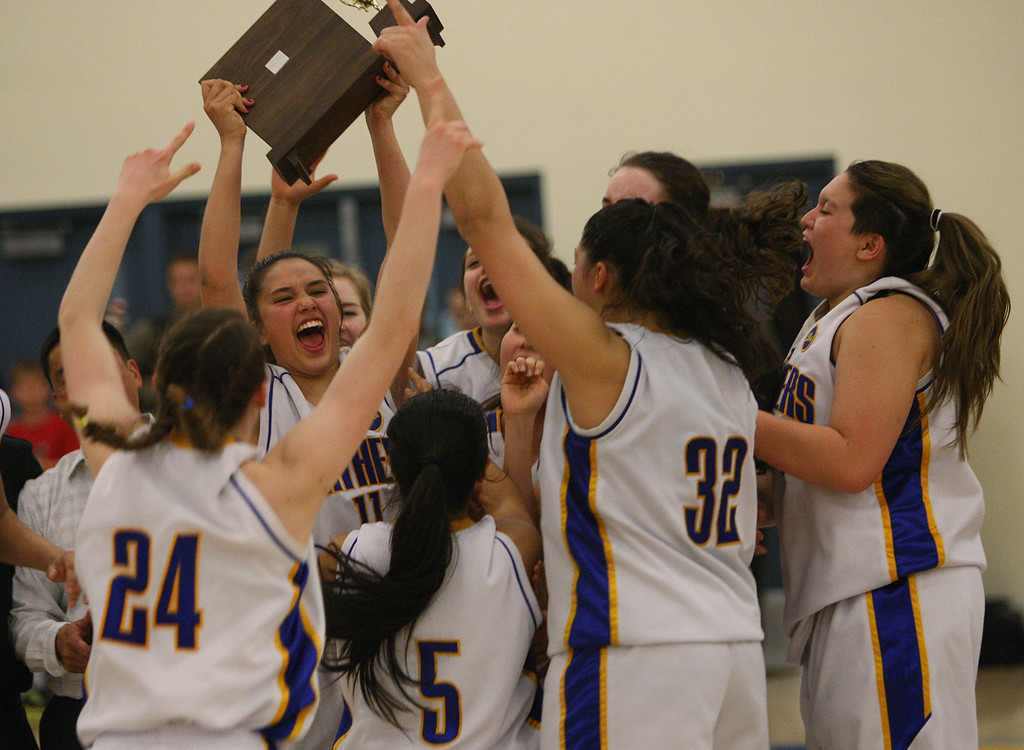 . Presentation\'s Courtney Danna holds up the CCS trophy after the game during the CCS Division II girls basketball finals at Santa Clara High School in Santa Clara, Calif. on Friday, March 1, 2013. The Presentation Panthers beat the Woodside Wildcats, 49-34. (Jim Gensheimer/Staff)