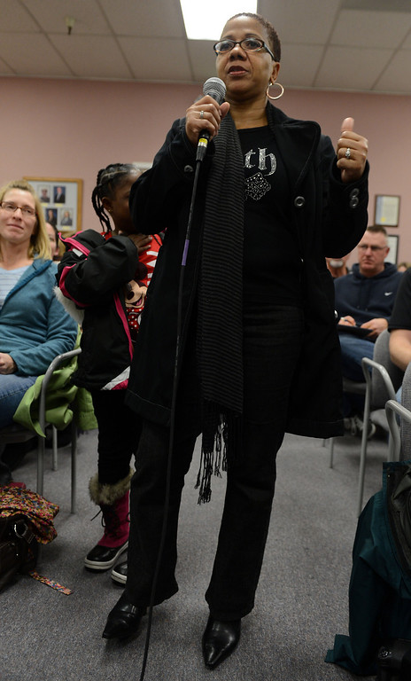 . Yolanda Jackson, with her daughter at her side, addresses Brentwood Union School District school board members at a meeting  in Brentwood, Calif., on Wednesday, Jan. 23, 2013.  Jackson said her special needs daughter was found wandering away from the school and wants to know that her child is safe while at school.  (Susan Tripp Pollard/Staff)