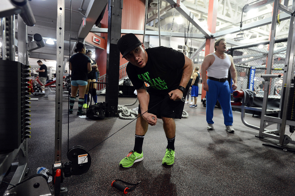 . Daniel Marin, of Pittsburg, works out at the UFC gym in Concord, Calif. on Monday, Jan. 7, 2013. Studies have looked at a correlation between appearance and performance, with some suggesting a link between looking good and performing well. (Kristopher Skinner/Staff)