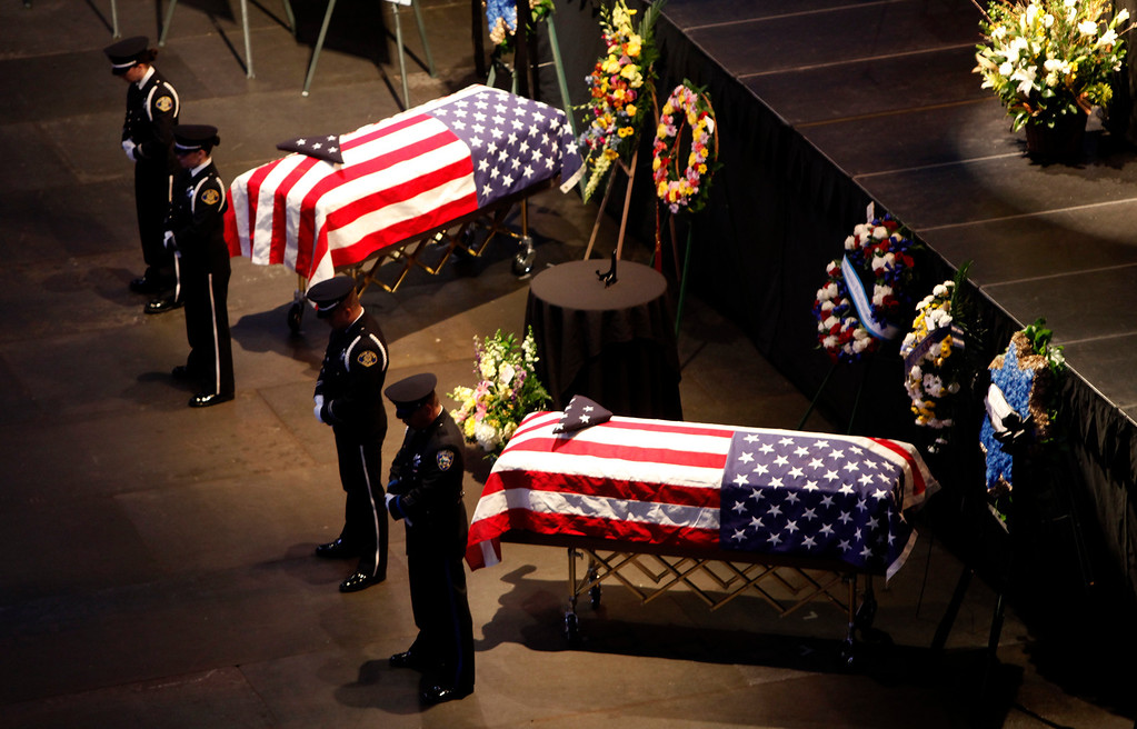 ". An honor guard stands watch over the caskets of Santa Cruz police officers Sgt. ""Butch\"" Baker and Detective Elizabeth Butler at the HP Pavilion on Thursday, March 7, 2013 in San Jose, Calif. The officers were killed during an ambush in Santa Cruz last week. (Karl Mondon/Staff)"
