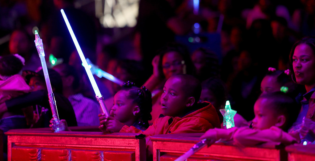 . Children hold light sabers as they watch the UniverSoul Circus perform under the big top on Hegenberger Road in Oakland, Calif., on Friday, April 5, 2013.  (Jane Tyska/Staff)